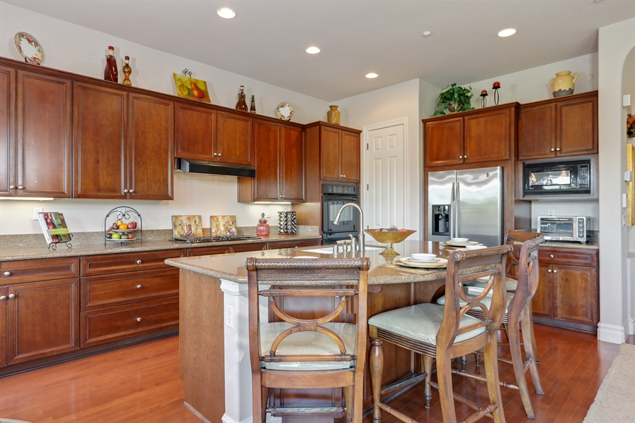 Real Estate Photography - 4420 Longview Dr, Rocklin, CA, 95677 - Kitchen With Island And Large Walk-In Pantry