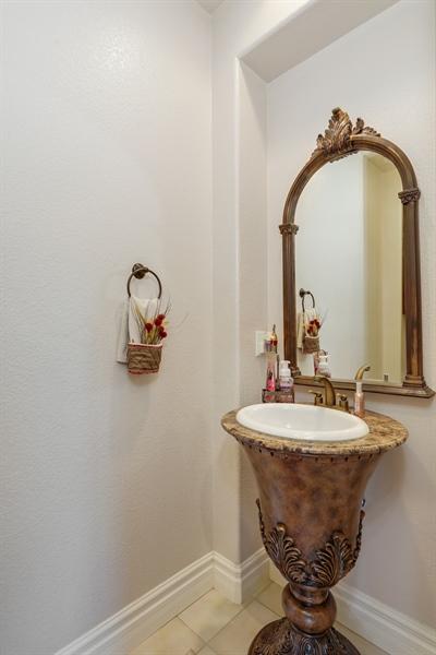 Real Estate Photography - 4420 Longview Dr, Rocklin, CA, 95677 - Powder Room With A Rare Find Bathroom Vanity