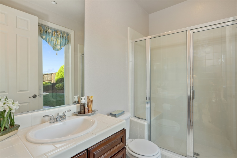 Real Estate Photography - 4420 Longview Dr, Rocklin, CA, 95677 - Guest Suite Full Bath With Access To The Backyard