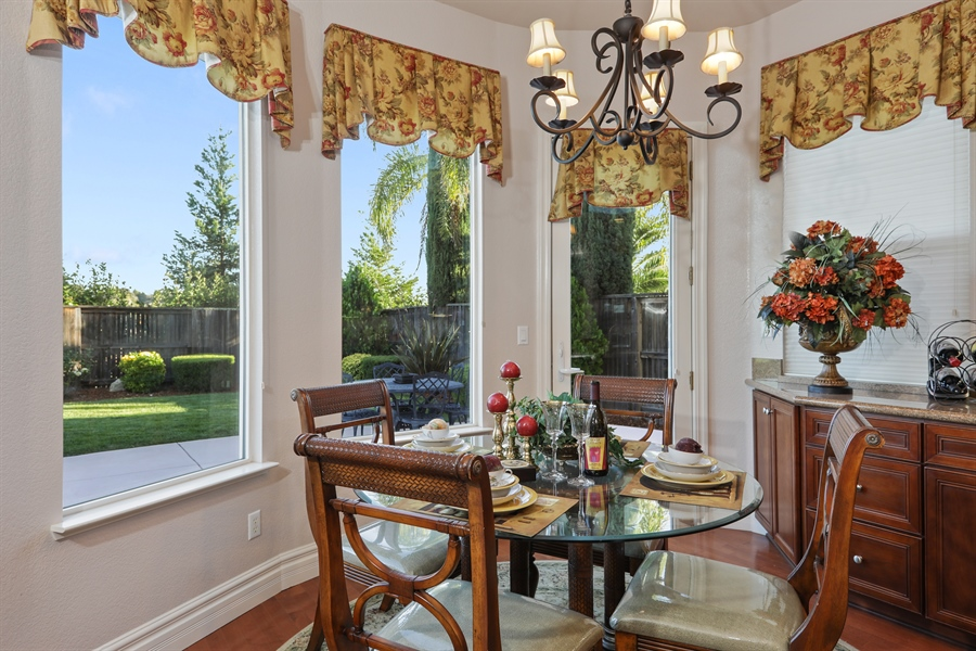 Real Estate Photography - 4420 Longview Dr, Rocklin, CA, 95677 - Dining Nook With French Door Leading To Backyard