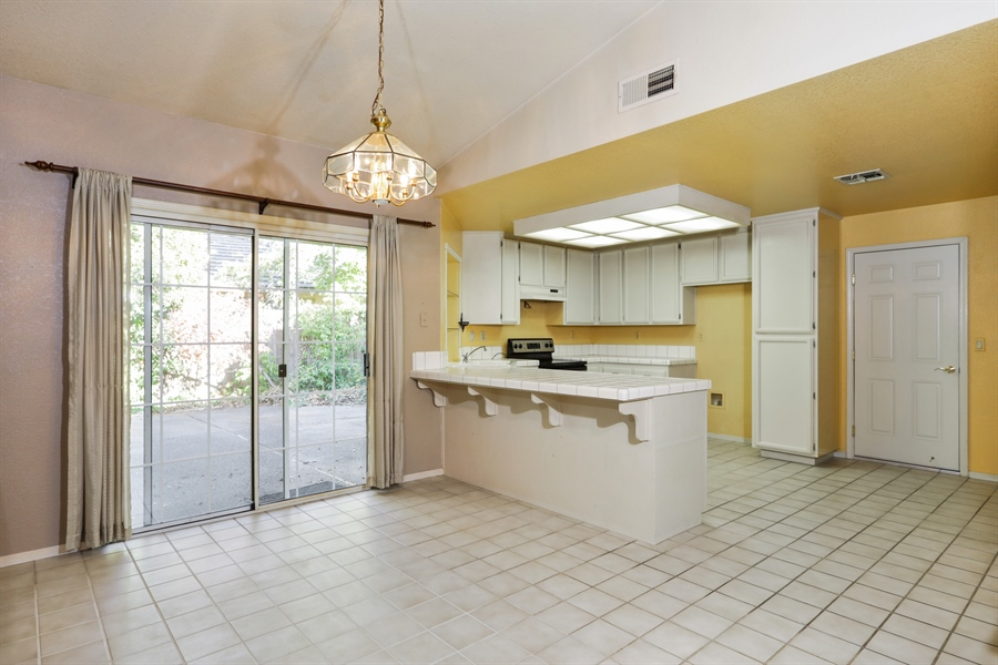 Real Estate Photography - 9417 Forest Vista Way, Elk Grove, CA, 95758 - Kitchen / Dining Room