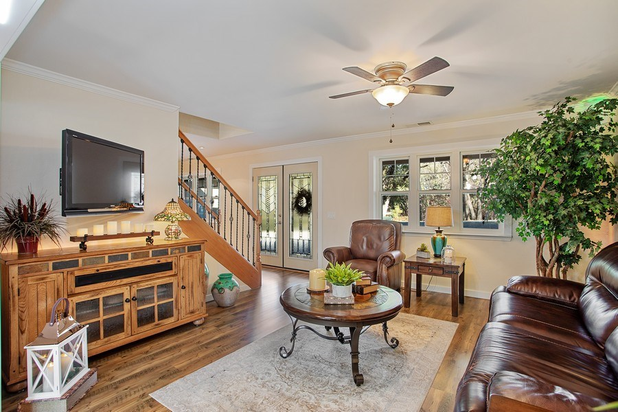 Real Estate Photography - 711 Quail Haven Rd, Colfax, CA, 95713 - Living room. Stairs lead to Bedrooms 2 & 3, and 3r