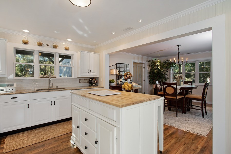 Real Estate Photography - 711 Quail Haven Rd, Colfax, CA, 95713 - Butcher block island with pull-out table.