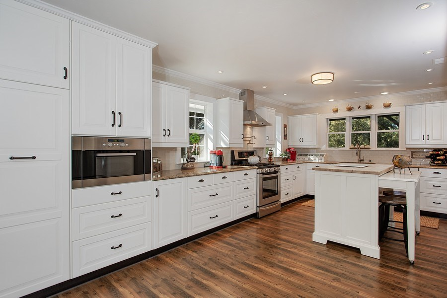 Real Estate Photography - 711 Quail Haven Rd, Colfax, CA, 95713 - Quartz countertops. Pantry cabinet. Stainless stee