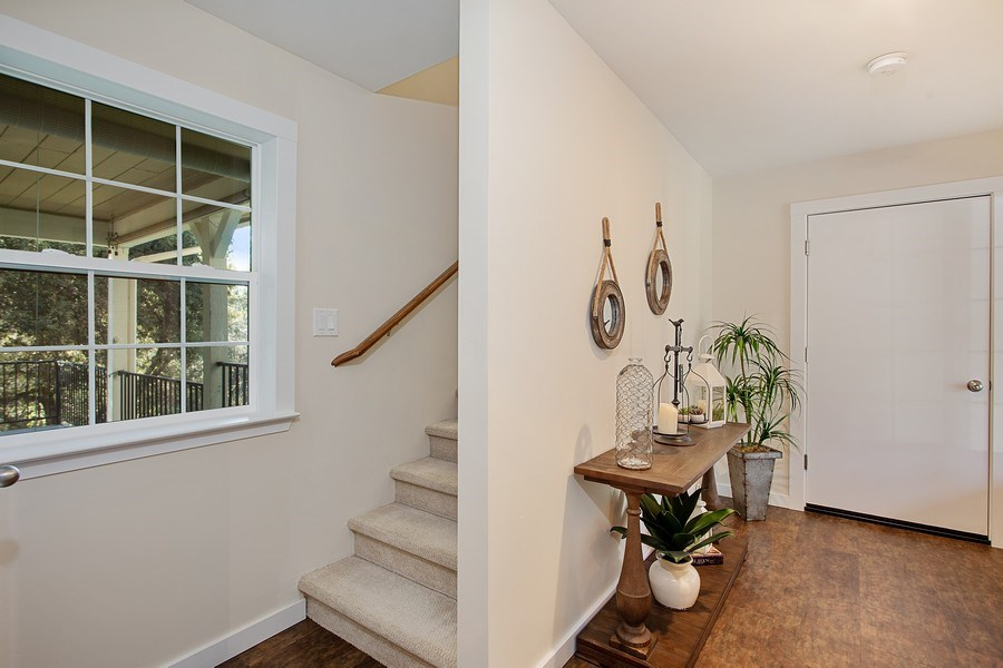 Real Estate Photography - 711 Quail Haven Rd, Colfax, CA, 95713 - Back entryway from garage. Stairs lead to master s