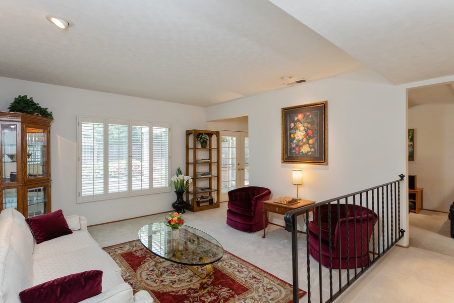 Real Estate Photography - 8539 La Riviera Dr, Sacramento, CA, 95826 - Spacious Living Room overlooks pool & backyard!