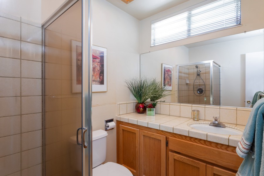 Real Estate Photography - 8539 La Riviera Dr, Sacramento, CA, 95826 - Natural light from window in Master Bathroom!