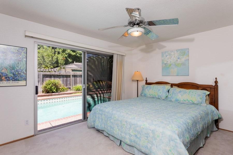 Real Estate Photography - 8539 La Riviera Dr, Sacramento, CA, 95826 - Master Bedroom has access to the pool!