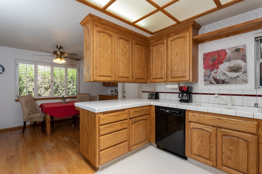 Real Estate Photography - 8539 La Riviera Dr, Sacramento, CA, 95826 - Kitchen opens to dining area!
