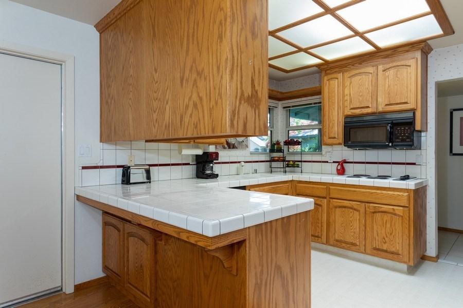 Real Estate Photography - 8539 La Riviera Dr, Sacramento, CA, 95826 - Light & bright Kitchen!
