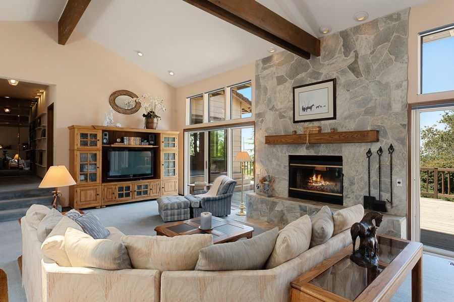 Real Estate Photography - 3570 Skyview Dr, Auburn, CA, 95602 - Beautiful rock fireplace is a focal point of the l