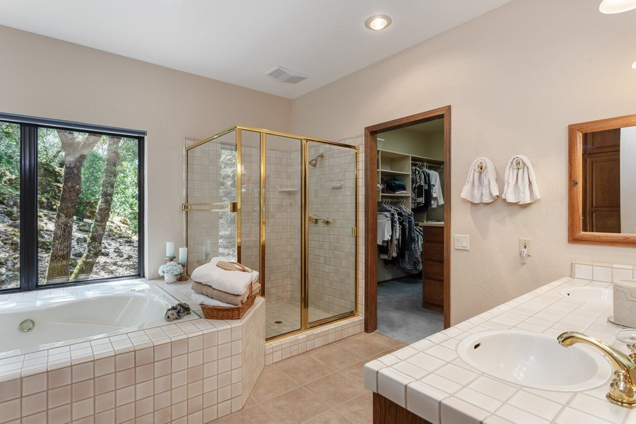 Real Estate Photography - 3570 Skyview Dr, Auburn, CA, 95602 - Master bath with adjacent walk-in closet.