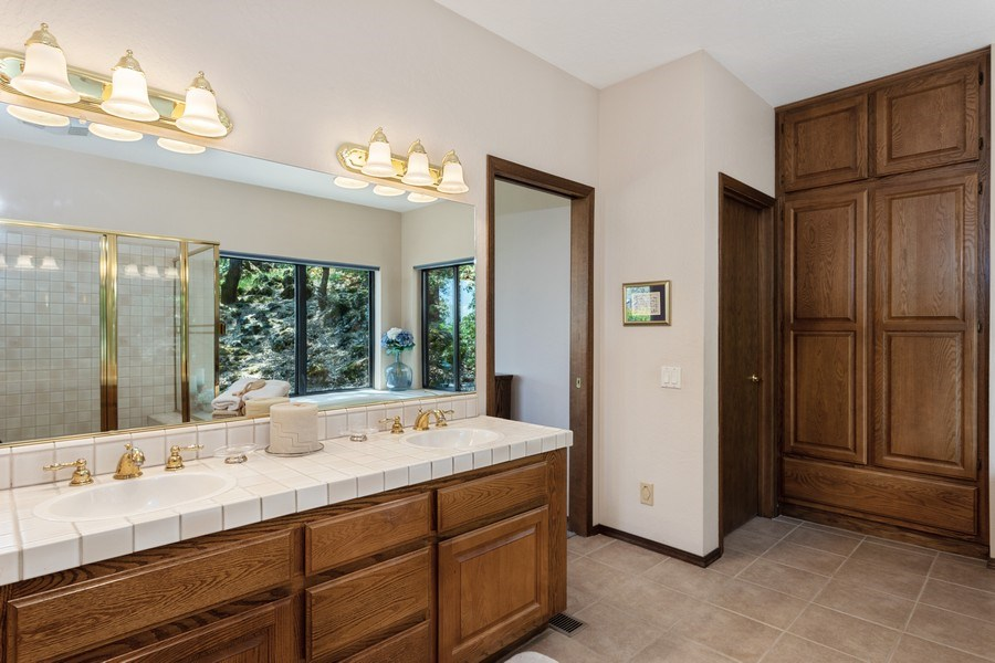 Real Estate Photography - 3570 Skyview Dr, Auburn, CA, 95602 - Master bath with dual sinks, spacious linen cabine