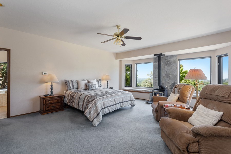 Real Estate Photography - 3570 Skyview Dr, Auburn, CA, 95602 - Spacious master suite with sitting area, window se