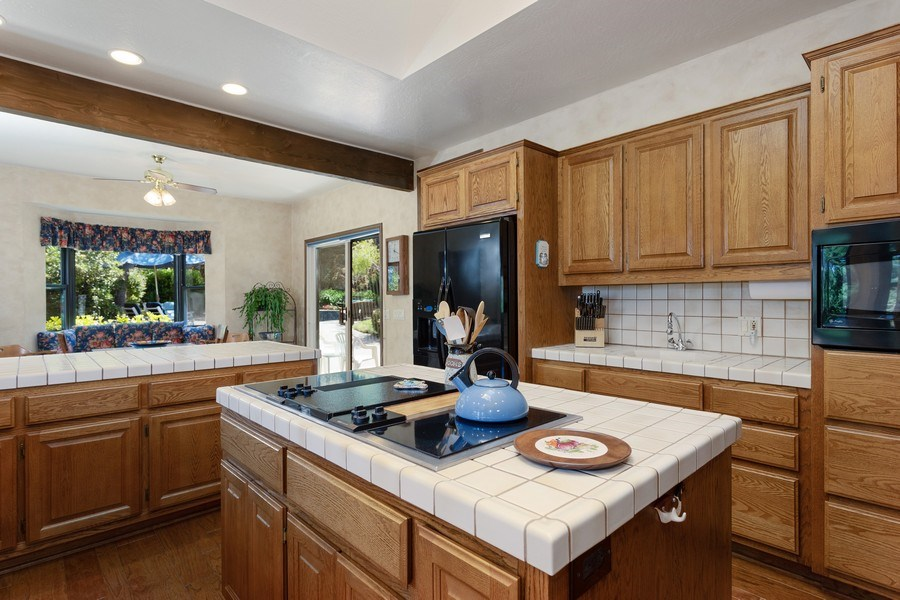 Real Estate Photography - 3570 Skyview Dr, Auburn, CA, 95602 - Another view of the kitchen with the breakfast noo