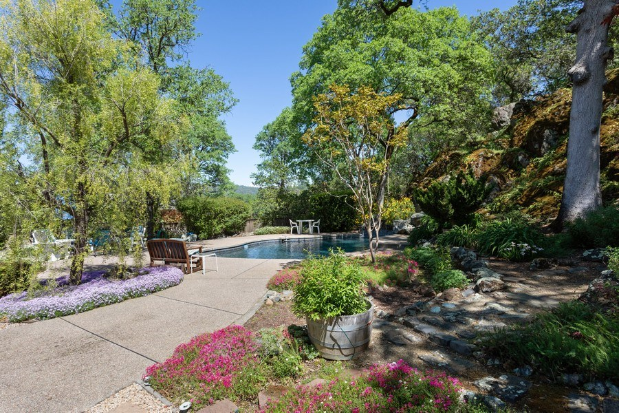 Real Estate Photography - 3570 Skyview Dr, Auburn, CA, 95602 - Lovely backyard with colors that change with the s
