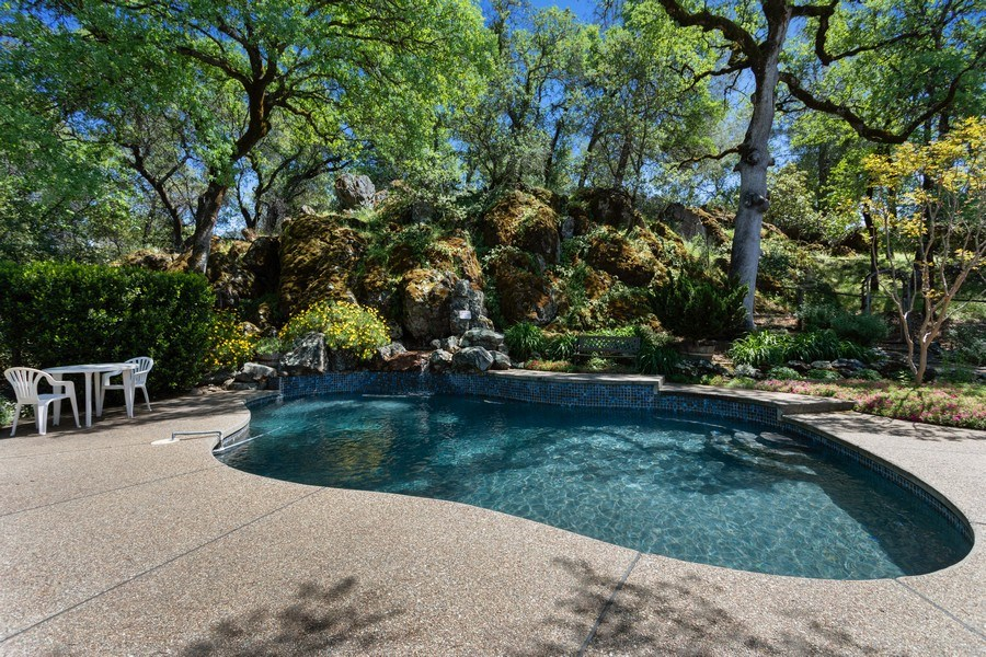 Real Estate Photography - 3570 Skyview Dr, Auburn, CA, 95602 - Amazing setting for the pool, tucked into a natura