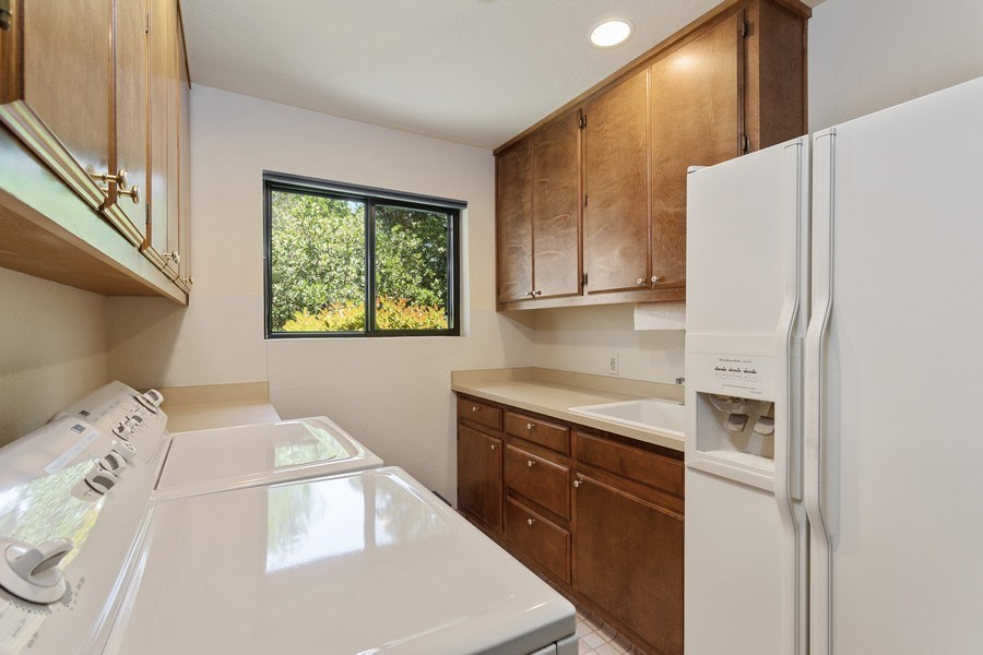 Real Estate Photography - 3570 Skyview Dr, Auburn, CA, 95602 - Spacious laundry room with cabinets, sink, room fo