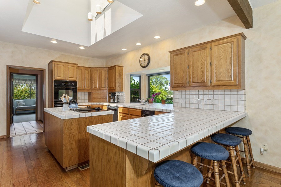 Real Estate Photography - 3570 Skyview Dr, Auburn, CA, 95602 - Kitchen with island, bar. Big window for plants. S