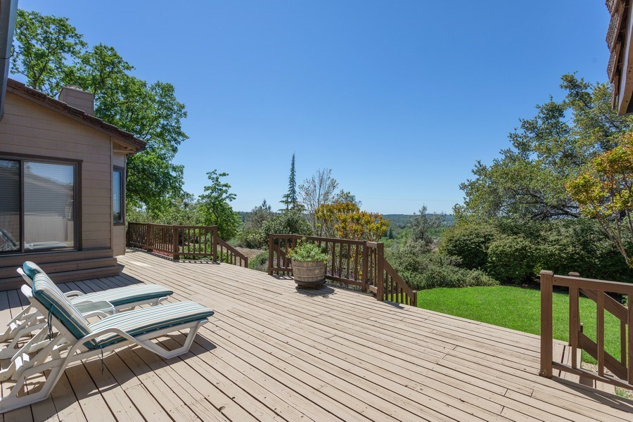 Real Estate Photography - 3570 Skyview Dr, Auburn, CA, 95602 - Spacious front deck with lawn. Enjoy the sunset vi