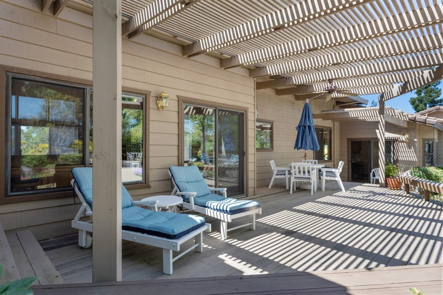 Real Estate Photography - 3570 Skyview Dr, Auburn, CA, 95602 - Shaded deck for outdoor enjoyment.