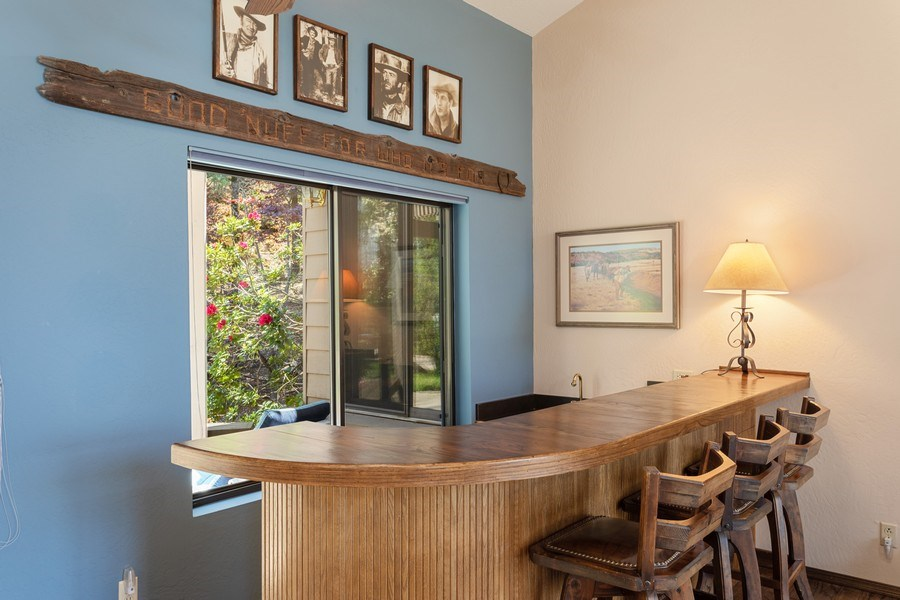 Real Estate Photography - 3570 Skyview Dr, Auburn, CA, 95602 - Entertaining bar in the corner of the living room.