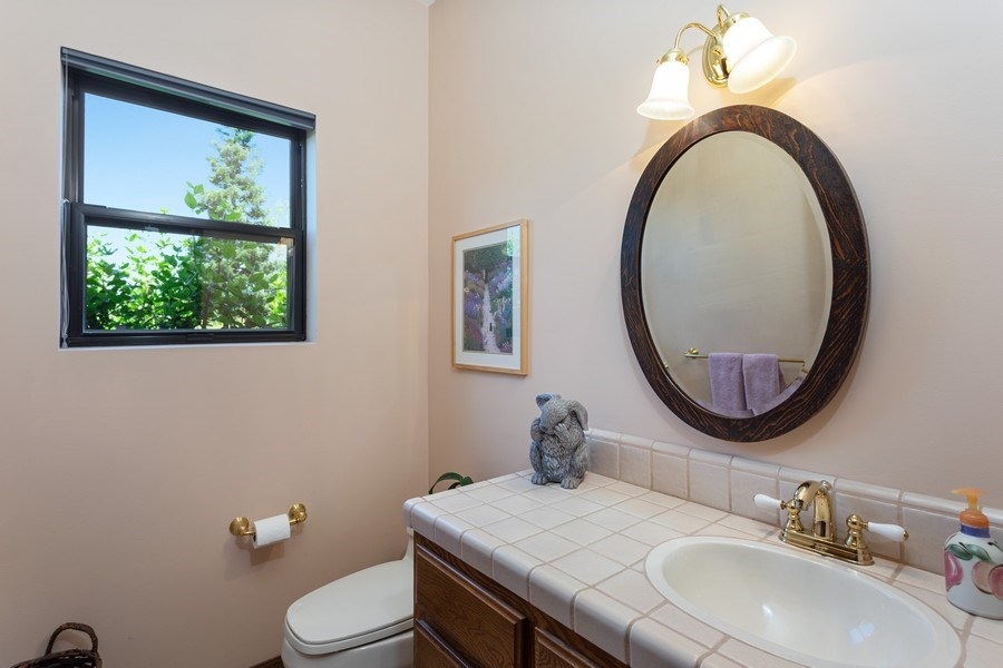 Real Estate Photography - 3570 Skyview Dr, Auburn, CA, 95602 - Half bath is near the front entry.