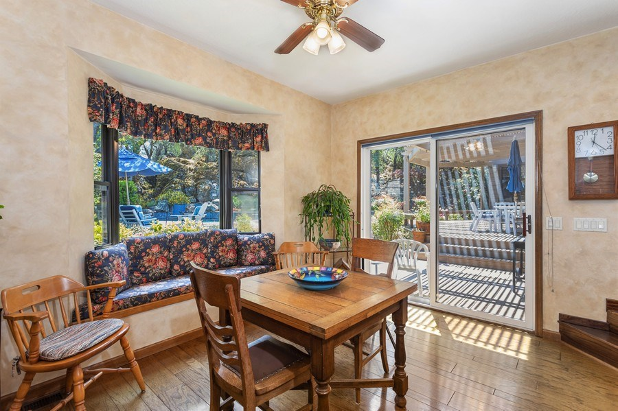 Real Estate Photography - 3570 Skyview Dr, Auburn, CA, 95602 - Breakfast nook with window seat, slider to back de