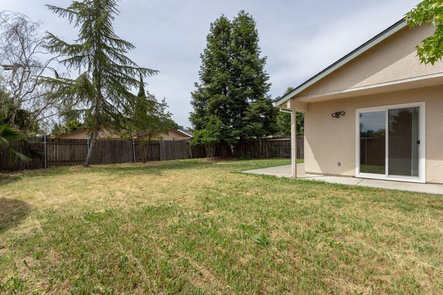 Real Estate Photography - 4570 Armadale Way, Sacramento, CA, 95823 - Back Yard
