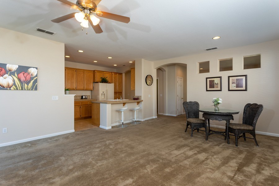 Real Estate Photography - 2799 Meadowland Way, Lincoln, CA, 95648 - Family Room / Dining Room