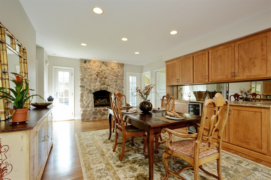 Real Estate Photography - 32 Oak Knoll Road, Barrington Hills, IL, 60010 - Breakfast Room with stone fireplace
