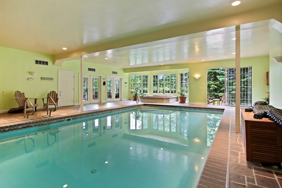 Real Estate Photography - 559 Oak Knoll Rd, Barrington Hills, IL, 60010 - Indoor Pool with Hot tub and Exercise Room adjacen