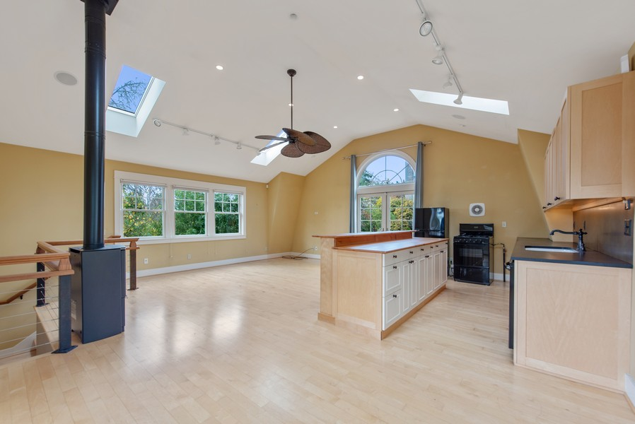 Real Estate Photography - 604 W Kinnear ST UPPER, Seattle, WA, 98119 - Kitchen/Living