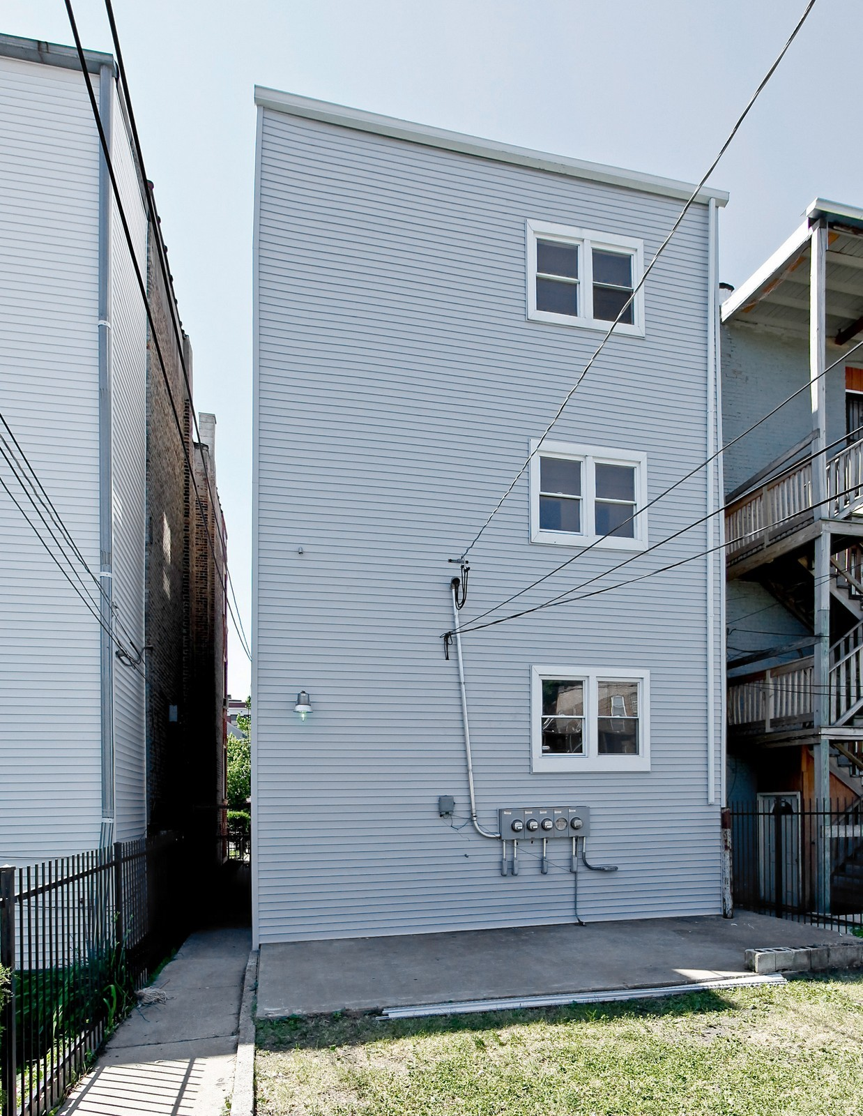 Real Estate Photography - 3332 W Polk St, Chicago, IL, 60624 - Rear View