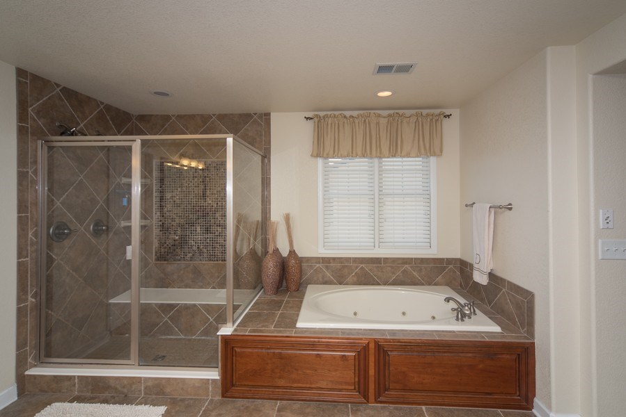 Real Estate Photography - 14345 Kalamath, Westminster, CO, 80023 - Master Shower and Bathtub