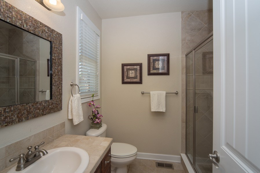 Real Estate Photography - 14345 Kalamath, Westminster, CO, 80023 - Main Level Guest Suite Bath