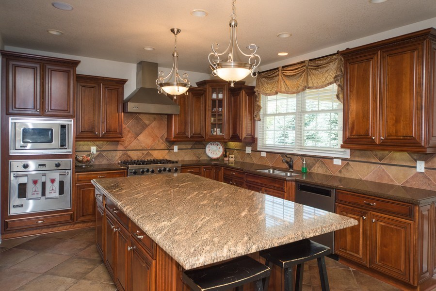 Real Estate Photography - 14345 Kalamath, Westminster, CO, 80023 - Chef's Kitchen