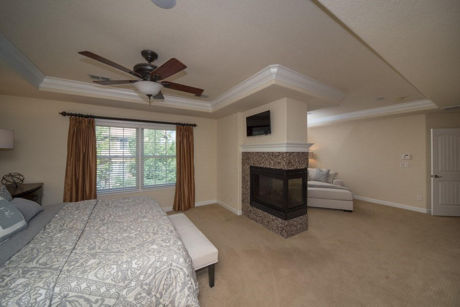 Real Estate Photography - 14345 Kalamath, Westminster, CO, 80023 - Master Suite with Double Sided Fireplace