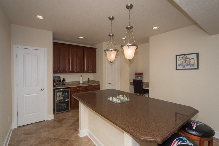 Real Estate Photography - 14345 Kalamath, Westminster, CO, 80023 - Basement Bar Area