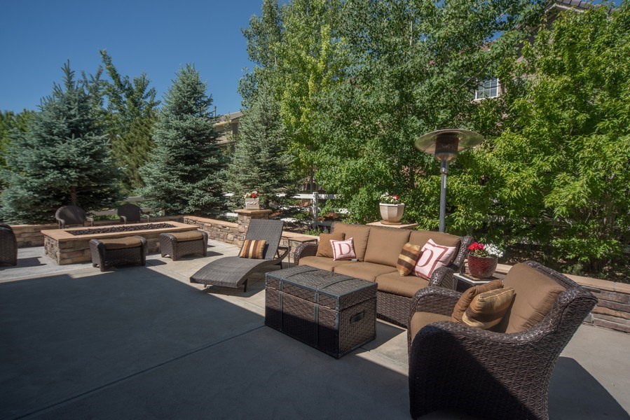 Real Estate Photography - 14345 Kalamath, Westminster, CO, 80023 - Extended Patio with Built In Firepit