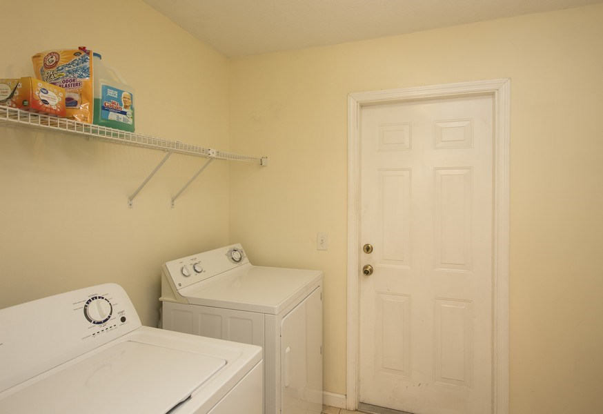 Real Estate Photography - 15 Coral Reef Court N, Palm Coast, FL, 32137 - Laundry Room