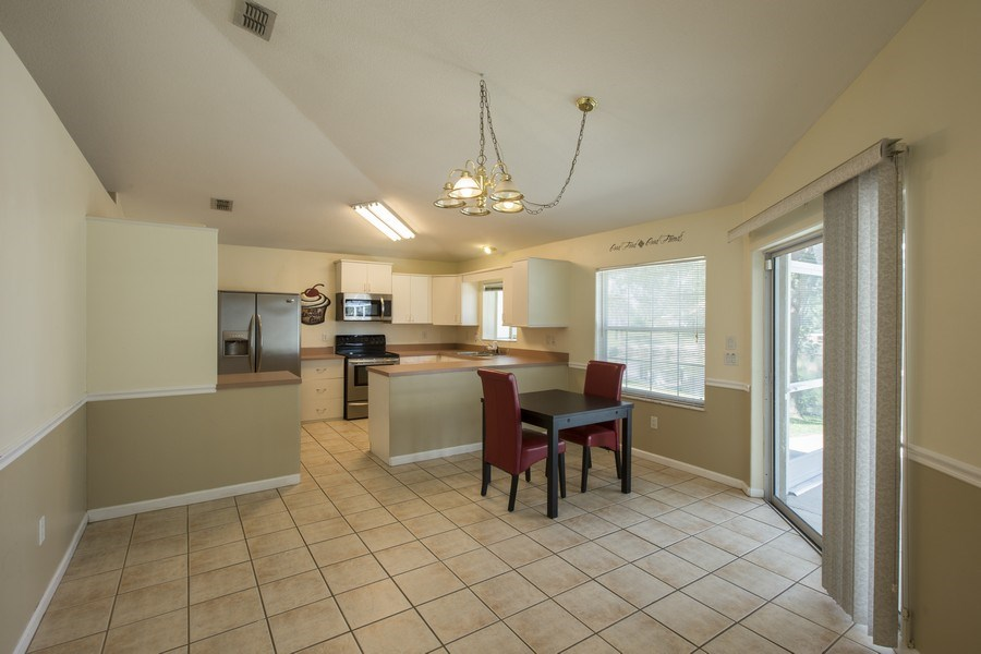 Real Estate Photography - 15 Coral Reef Court N, Palm Coast, FL, 32137 - Kitchen / Dining Room