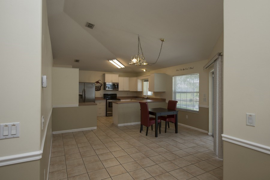 Real Estate Photography - 15 Coral Reef Court N, Palm Coast, FL, 32137 - Kitchen/Dining