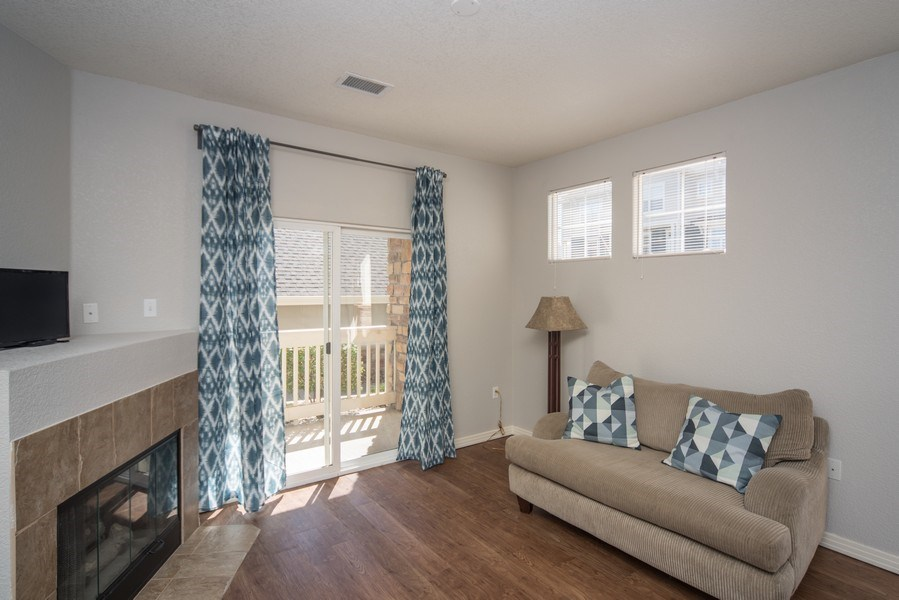 Real Estate Photography - 9527 Pearl Cir, Unit 102, Parker, CO, 80134 - Living Room