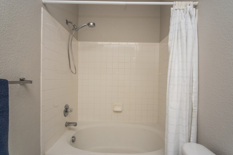 Real Estate Photography - 9527 Pearl Cir, Unit 102, Parker, CO, 80134 - Master Bathroom