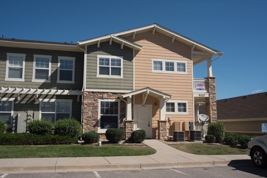 Real Estate Photography - 9527 Pearl Cir, Unit 102, Parker, CO, 80134 - Front View