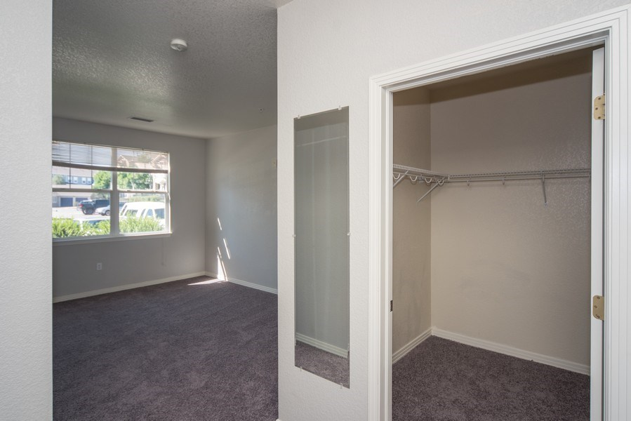 Real Estate Photography - 9527 Pearl Cir, Unit 102, Parker, CO, 80134 - Master Bedroom Closet