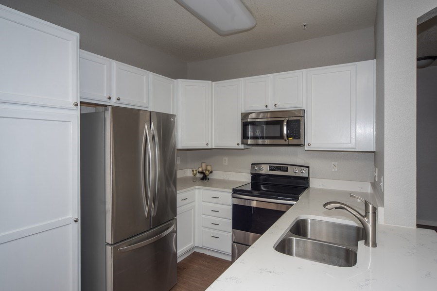 Real Estate Photography - 9527 Pearl Cir, Unit 102, Parker, CO, 80134 - Kitchen