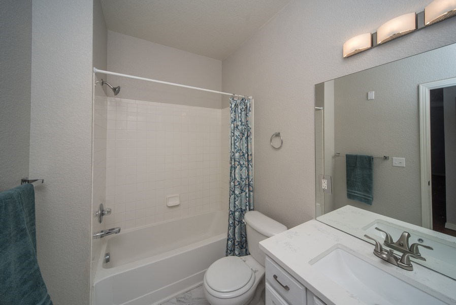 Real Estate Photography - 9527 Pearl Cir, Unit 102, Parker, CO, 80134 - Bathroom