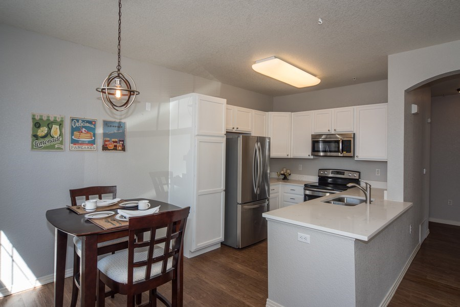 Real Estate Photography - 9527 Pearl Cir, Unit 102, Parker, CO, 80134 - Kitchen / Dining Room